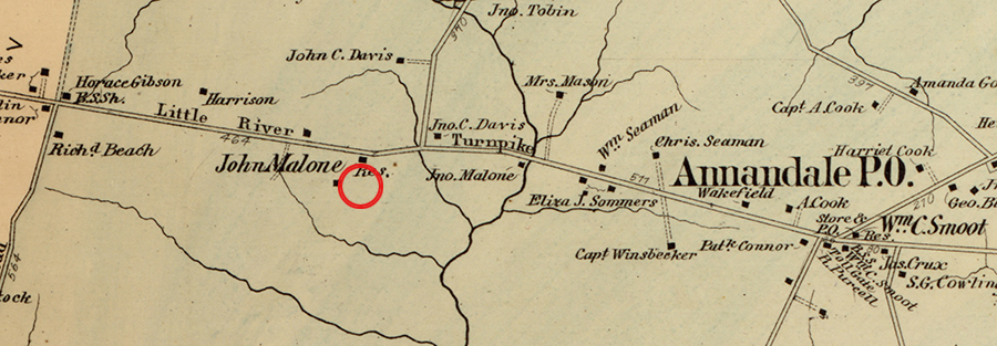 Color map of Fairfax County drawn in 1878 by Griffith Morgan Hopkins, provided courtesy of the Library of Congress. The approximate location of Wakefield Forest Elementary School is shown by a red circle. The map shows a portion of Little River Turnpike between modern day Guinea Road and the village of Annandale. The names of several landowners and the locations of their homes are pictured on the map.