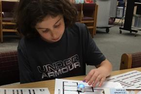 student working with an Ozobot in STEAM class