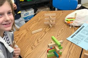 student building tower in STEAM class